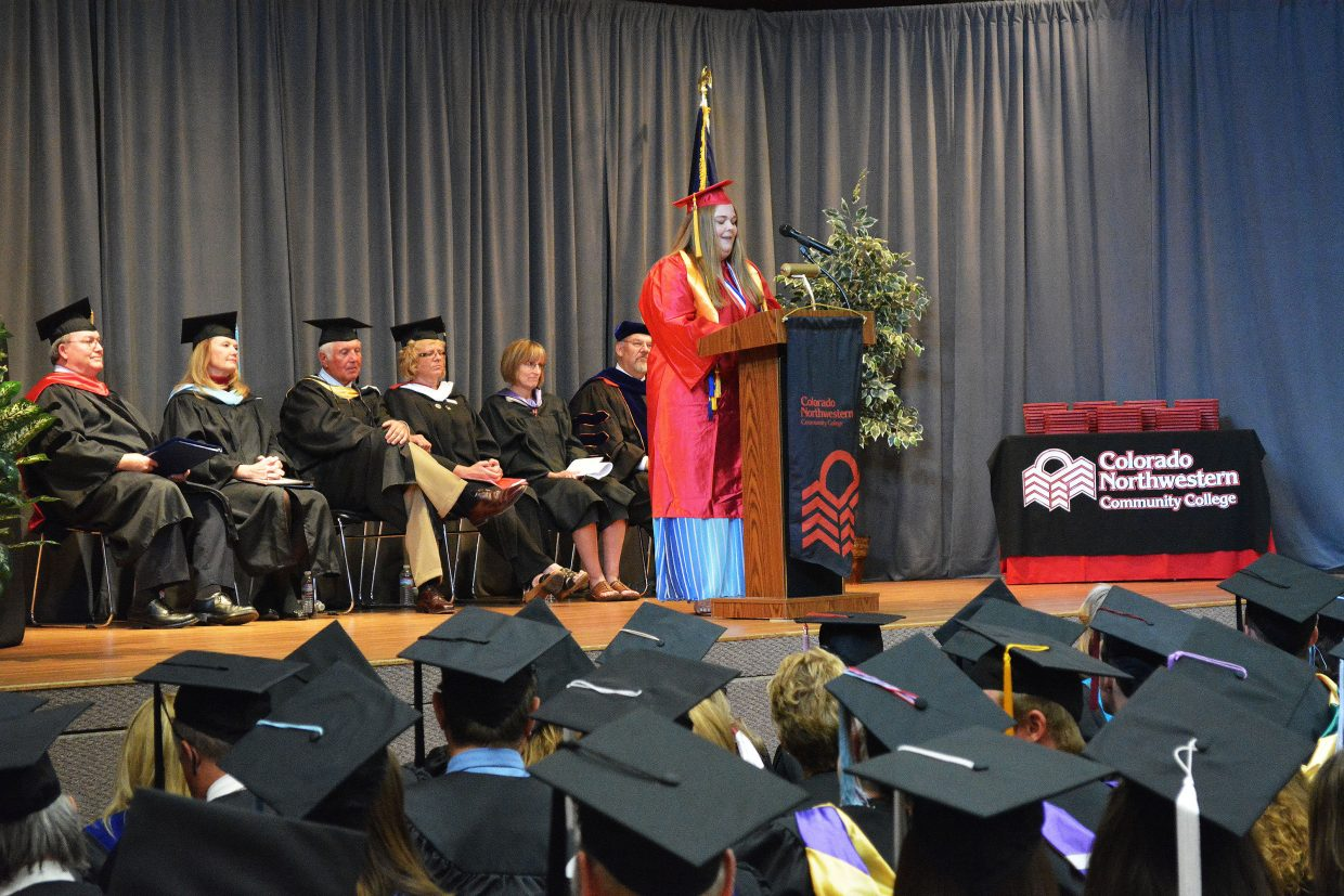 "Zoe Sowers, President of the CNCC Craig Student Government, addresses the graduates during the 50th commencement ceremony of Colorado Northwestern Community College. Zoe also sang an original song — called ""It IS Time"" — during the event, which took place at the CNCC campus in Rangely and celebrated the graduation of 80 students, 45 from the Craig campus and 35 from Rangely."