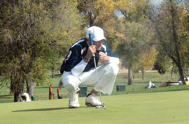 Wyndham Clark, a Valor Christian freshman, eyes his putt on the 18th green Monday. Clark leads the 4A high school golf state championships after the first round, carding a 66 in his 18 holes of work.