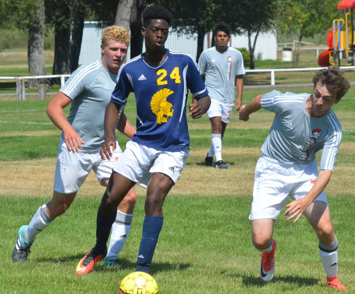 Colorado Northwestern Community College men's soccer players Logan Hopkins, left, and Michael Ross Vanhara double-team their opponent during a game against Trinidad State Junior College. CNCC men fell 5-0 to the Trojans.