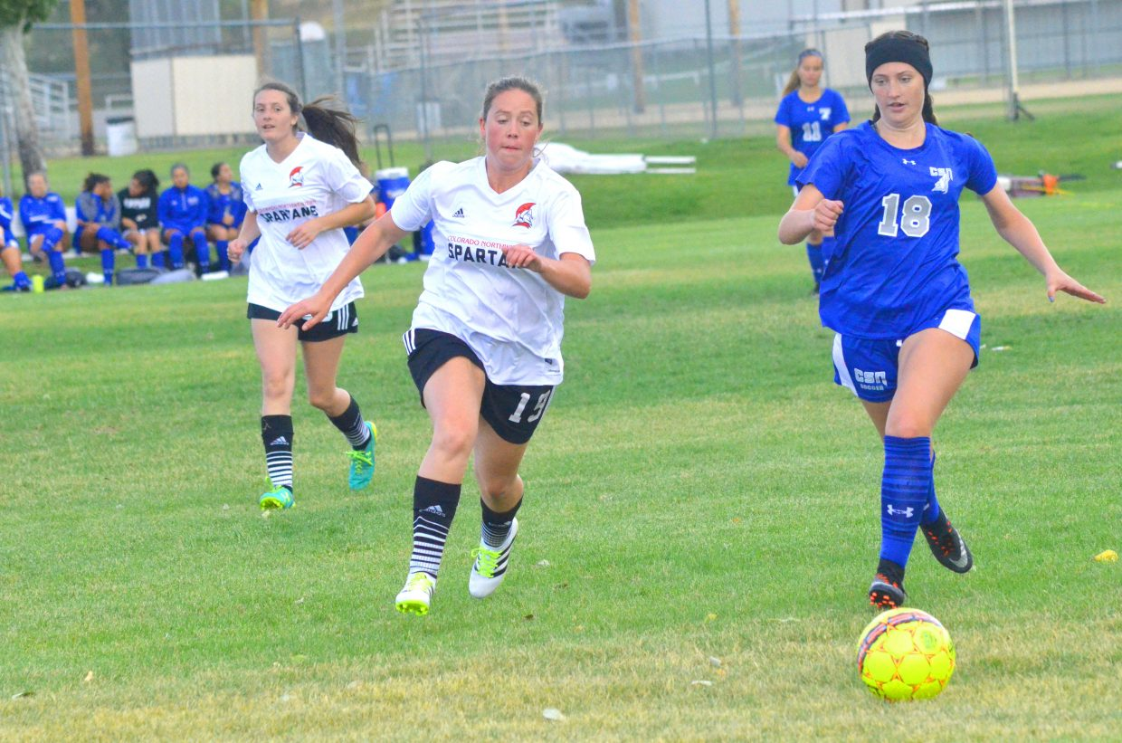 Colorado Northwestern Community College women's soccer players Hannah Walker, left, and Tawnee Julian flank College of Southern Nevada opponents. CNCC women took dual losses of 10-0 to the Coyotes last week.