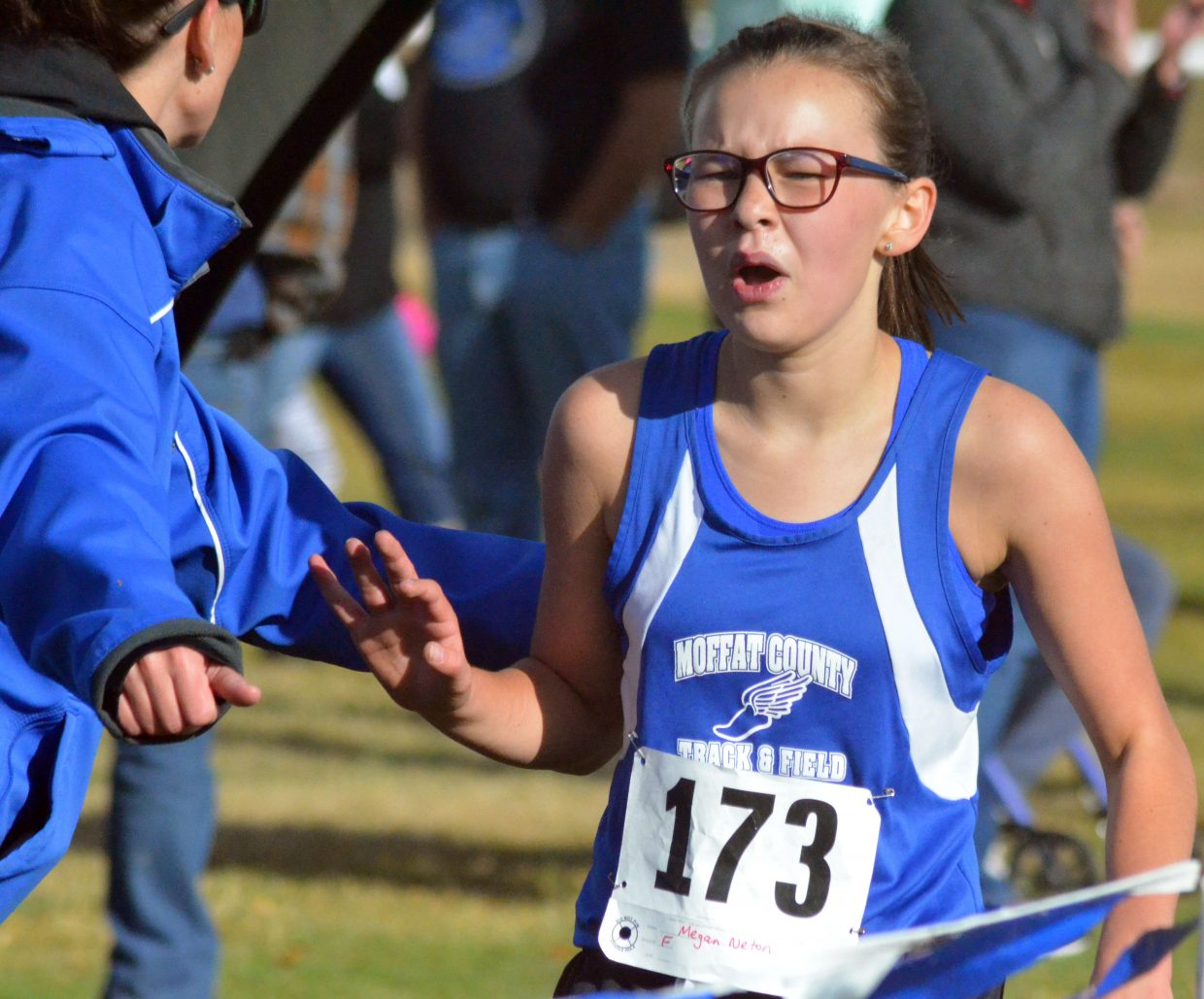 Craig Middle School cross country runner Megan Neton catches her breath following the Bulldog Invitational Saturday at Loudy-Simpson Park.