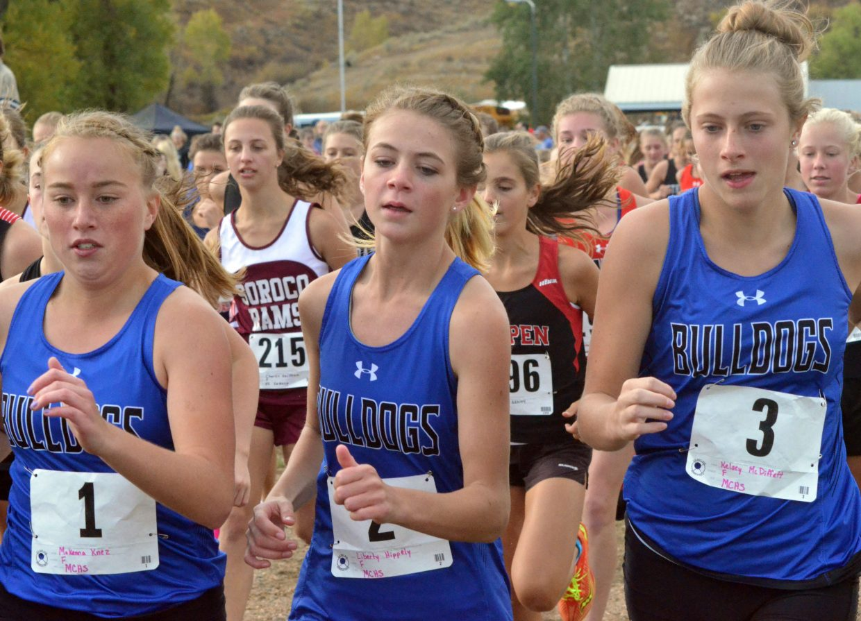 From left, Moffat County High School cross country runners Makenna Knez, Liberty Hippely and Kelsey McDiffett stick close together to start the girls race of the Bulldog Invitational Saturday at Loudy-Simpson Park. MCHS girls placed second, while boys won the event.