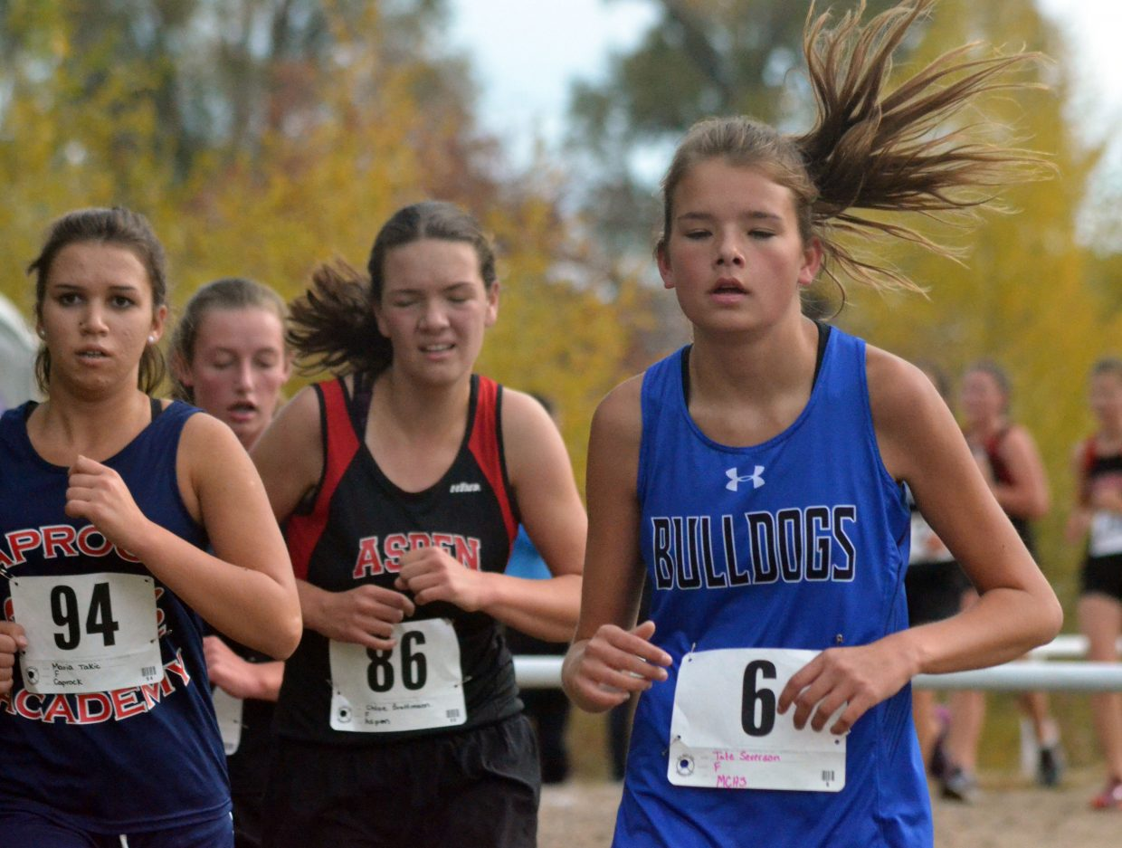 Moffat County High School cross country's Tate Severson stays in step with the pack during the Bulldog Invitational Saturday at Loudy-Simpson Park.