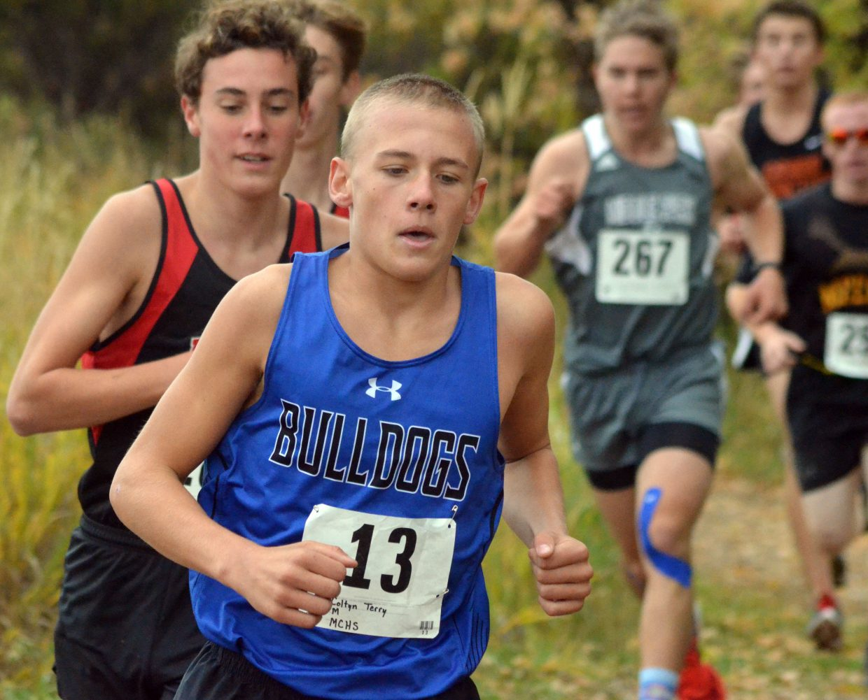 Moffat County High School's Coltyn Terry leads a wave of cross country runners through the Nature Trail during the Bulldog Invitational Saturday at Loudy-Simpson Park.