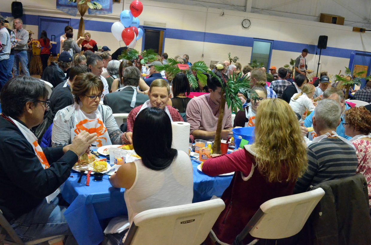 Tables are full at Boys & Girls Club of Craig as patrons tuck into their meals at Crabfest 2017.
