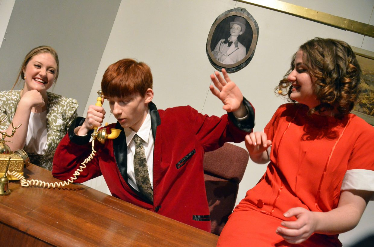 Annie (Courtney Smith), far right, proves a playful pest for Oliver Warbucks (Aaron Hill) to the amusement of Grace Farrell (Olivia Neece).
