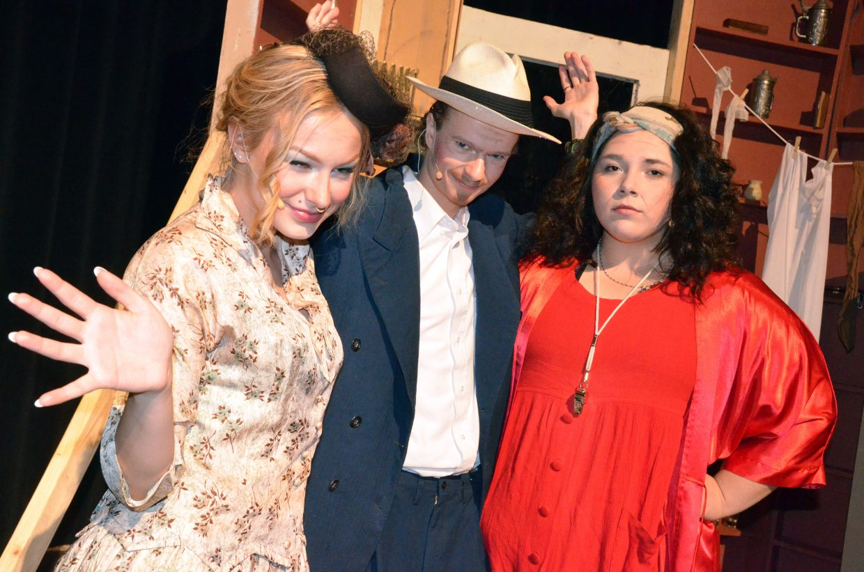 From left, Lily, Rooster and Miss Hannigan (Madelaine Peterson, Jeremy Looper, Tessona Gonzalez) concoct a scheme in