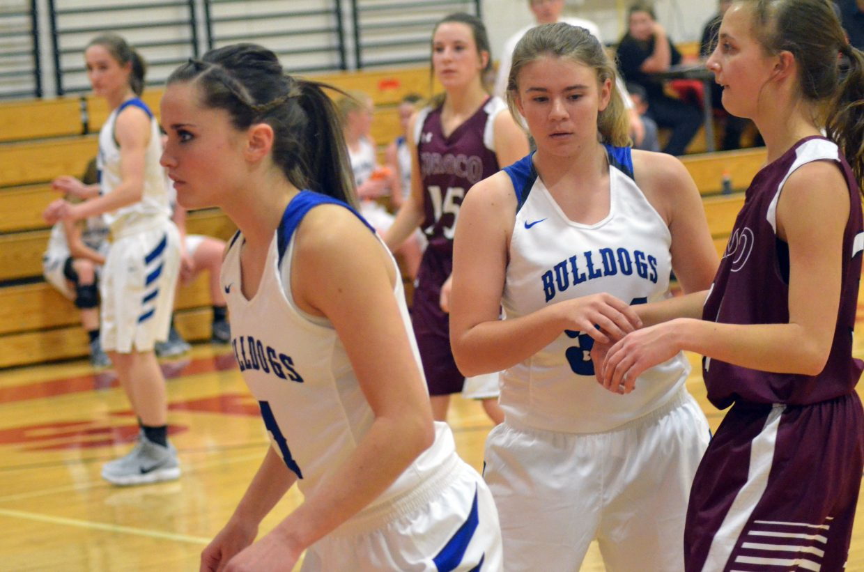 From left, Moffat County High School's Josie Timmer, Stephenie Swindler and Brittnee Meats stay alert on defense in final minutes against Soroco during the Steamboat Springs Shoot-Out. MCHS boys lost 78-43 to the Rough Riders.
