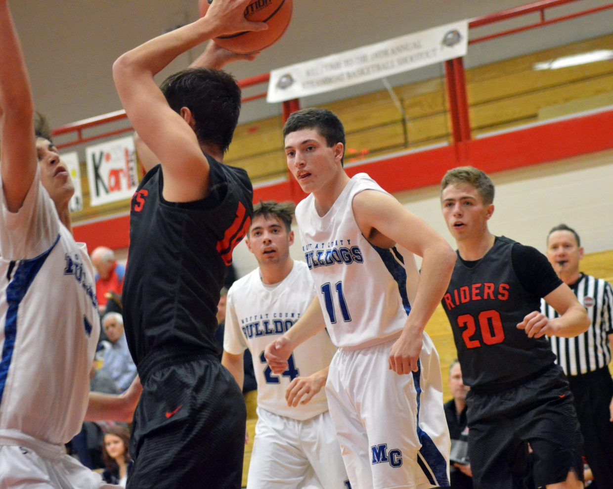 Moffat County High School's Jerod Chacon sticks close to Roosevelt's Christopher Podtburg as teammates Brent Cook and Connor Murphy stay alert during the Steamboat Springs Shoot-Out. MCHS boys lost 78-43 to the Rough Riders.