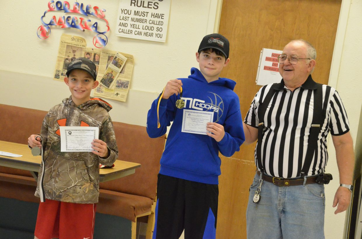 From left, Easton Briggs and Cort Murphy display second- and first-place medals provided by Frank Sadvar as the local winners of the 12- and 13-year-old boys division of the Elks National Hoop Shoot Free Throw Contest. The two went into three extra rounds of tiebreakers.