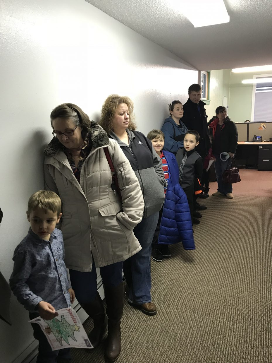 Local children wait patiently for their turns to meet Santa Claus during the annual Letters to Santa event, held Wednesday at the Craig Press.