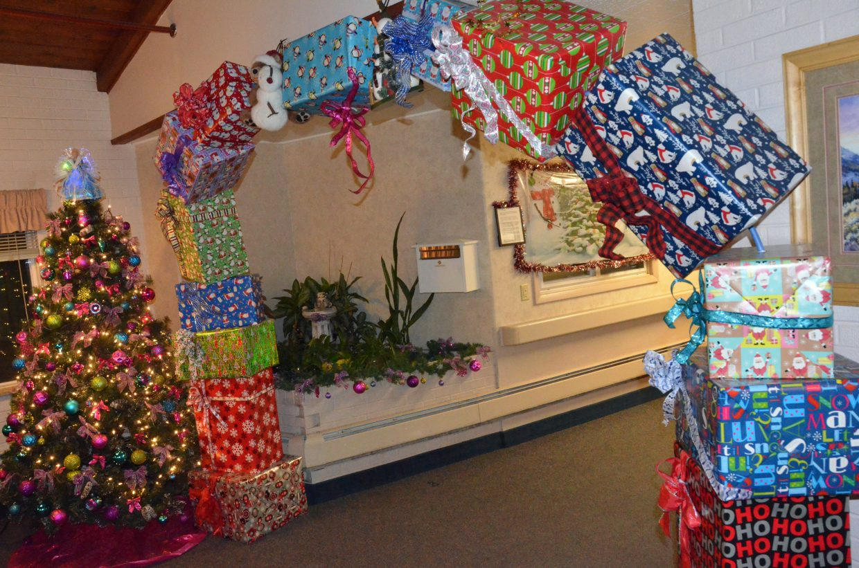 A Christmas tree and archway of holiday gifts show the halls are fully decked at Sandrock Ridge Care & Rehabilitation.