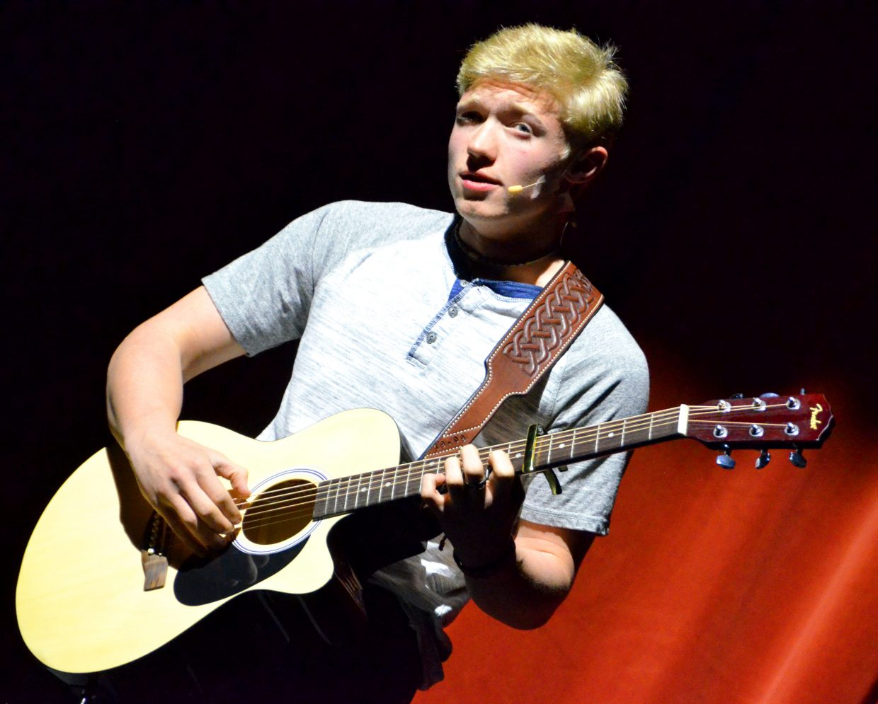 Logan Duke sings and strums to Ed Sheeran's