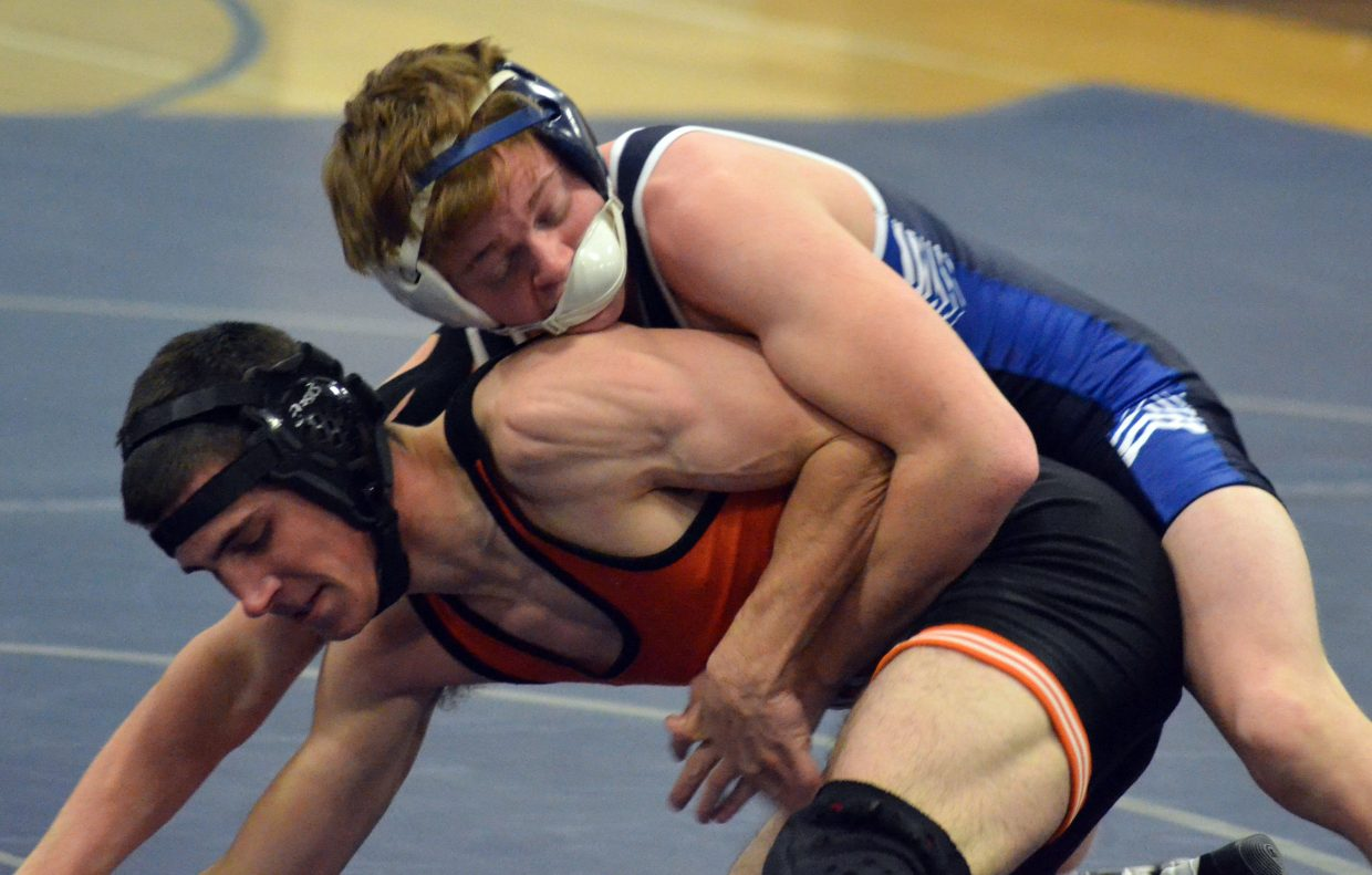 Moffat County High School's Chris Moschetti pushes back against resistance by  Hayden's Wade Hendricks during a Thursday dual in Craig.