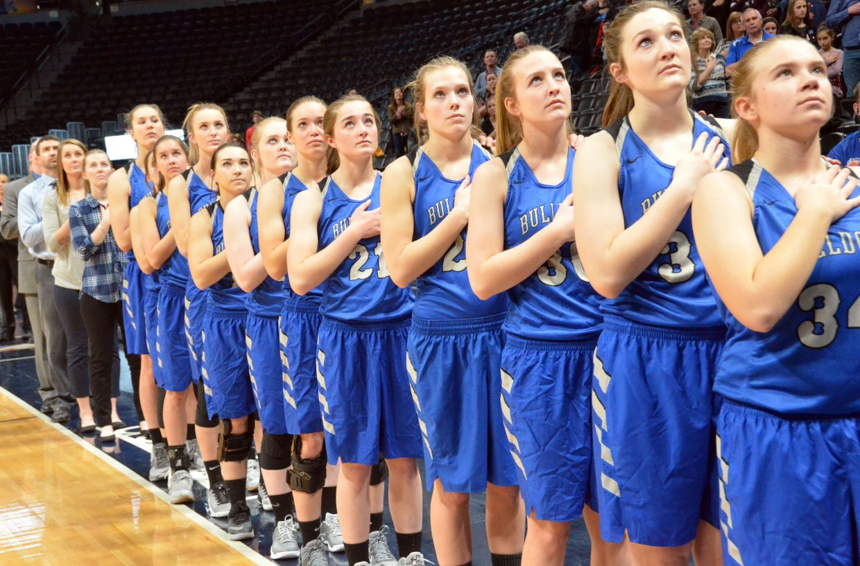 The Moffat County High School girls basketball team commemorate the national anthem Friday leading up to a game with Aspen at the Pepsi Center in Denver. MCHS won 61-25 against the Skiers.