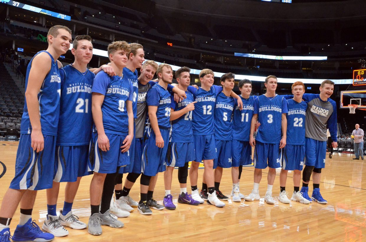 The Moffat County High School boys basketball team savors one final moment together Friday following a win over Aspen at the Pepsi Center in Denver. MCHS won 59-37.