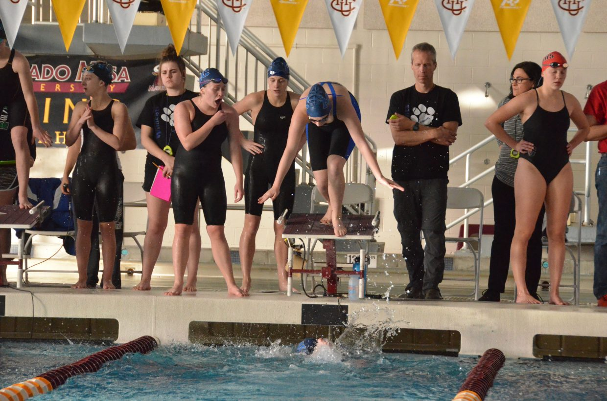 Moffat County High School's Molly Neton and Kelsey McDiffett cheer on Alexa Neton as she leaps off the starting block while Katelynn Turner completes her leg of the 200-yard freestyle relay Saturday at the Southwestern Conference League Championships.