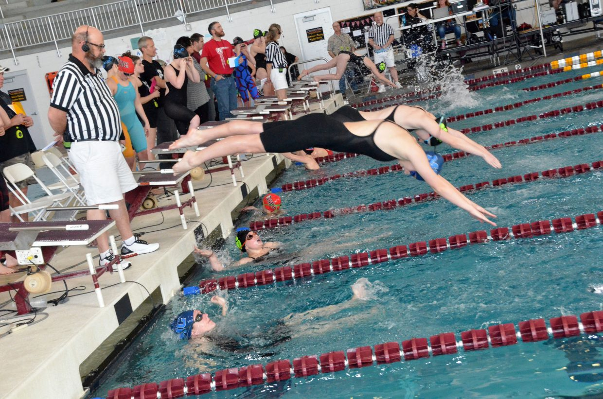Moffat County High School's Kelsey McDiffett dives in as teammate Katelynn Turner ends her leg of the 200-yard medley relay  Saturday at the Southwestern Conference League Championships.