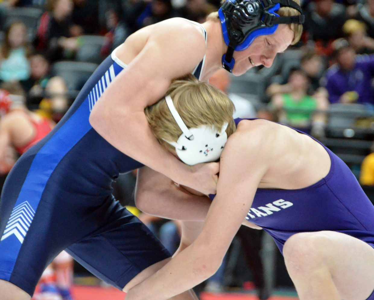 Moffat County High School wrestler isiaih Herod puts up resistance against Salida's Ryan Moltz during the opening round of CHSAA State Championships.