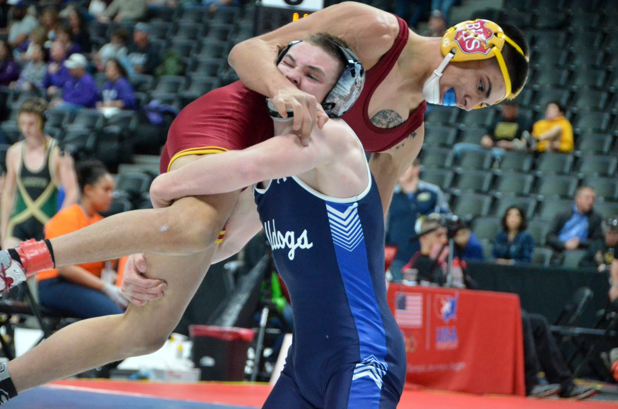 Moffat County High School wrestler Daniel Caddy lifts Brush's Oswaldo Nunez off the mat during the opening round of CHSAA State Championships.