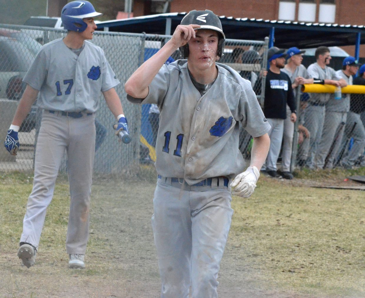 Moffat County High School's Connor Murphy is covered in dirt and baseline chalk after sliding into home.