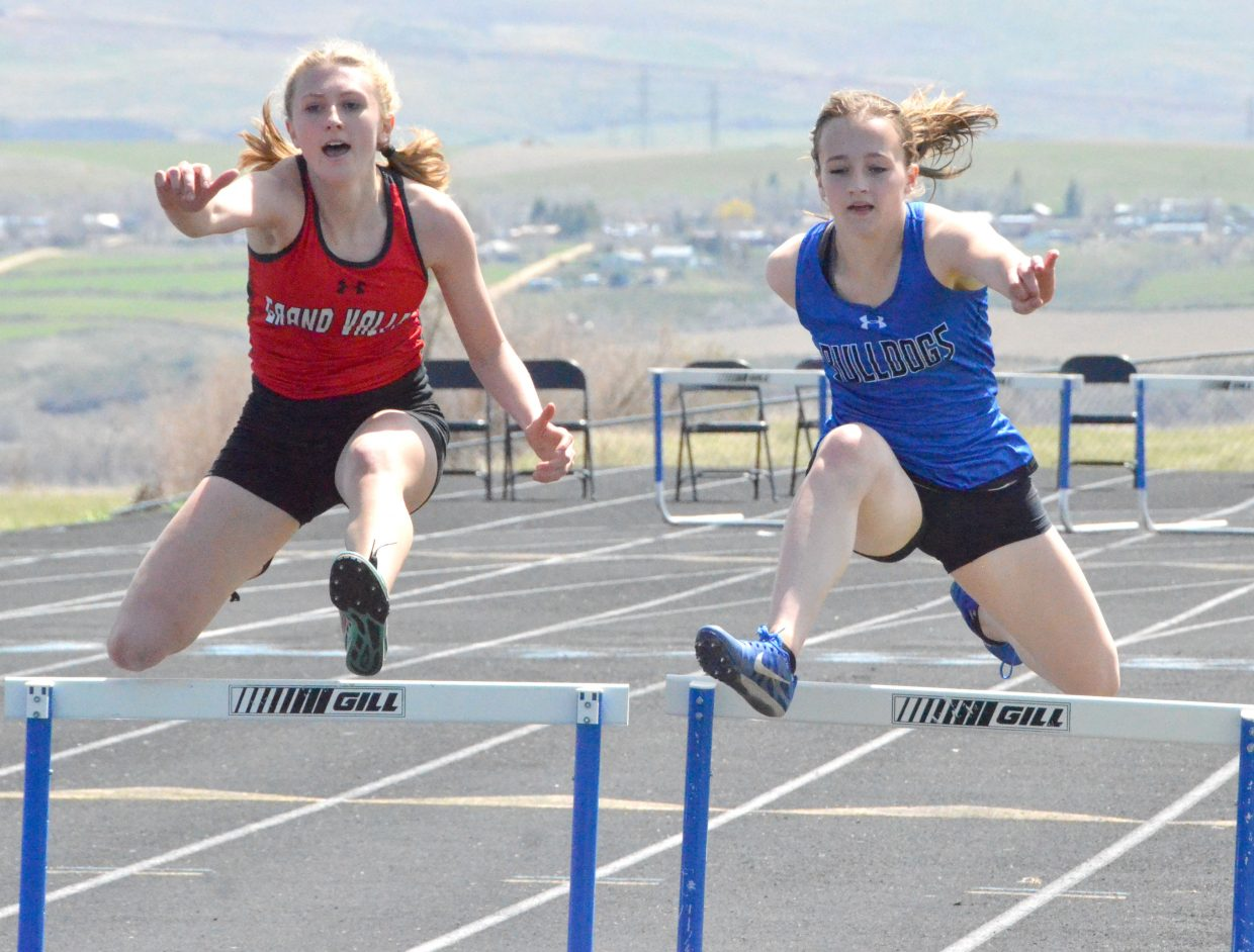 Moffat County High School's Alayna Behrman vaults everything in her way during the girls 300-meter hurdles Friday at the Clint Wells Invitational.