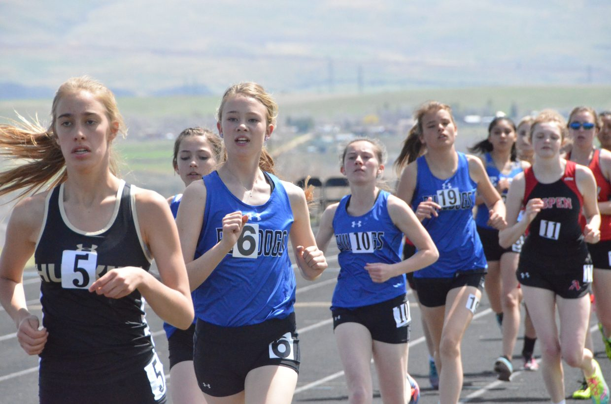 From left, Moffat County High School's Madison Atkin, Sara Beason, Allison Villard and Tate Severson hug the inside edge of the track in the 800-meter run Friday at the Clint Wells Invitational.