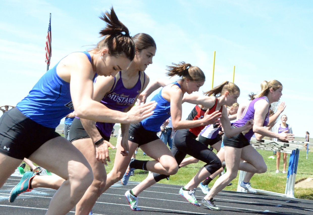 Moffat County High School's Quinn Pinnt, left, and Emaleigh Papierski keep their heads tucked to start the girls 100-meter dash Friday at the Clint Wells Invitational.