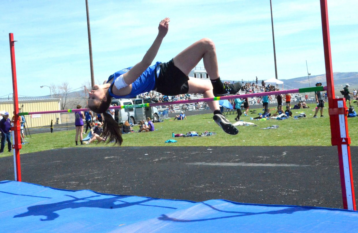 Moffat County High School's Brooke Gumber leans back for the flop in the girls high jump Friday at the Clint Wells Invitational.