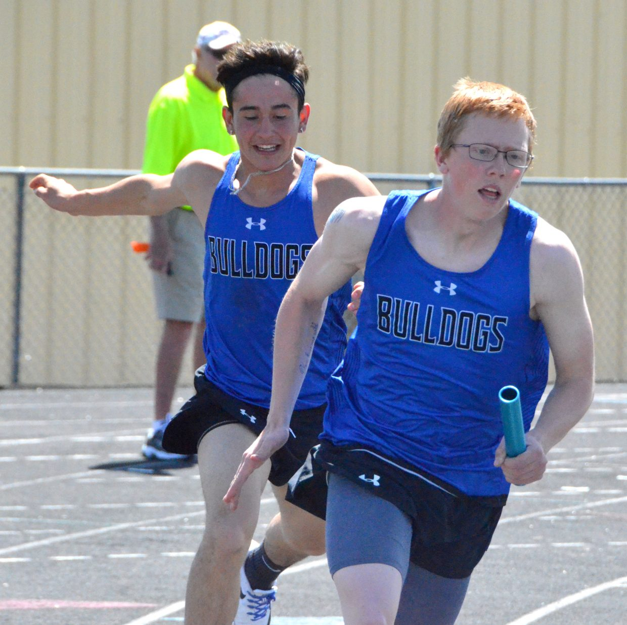 Moffat County High School's Trenton Hillewaert, front, takes off after receiving the baton from Juan Loya in the boys 4x200-meter relay Friday at the Clint Wells Invitational.