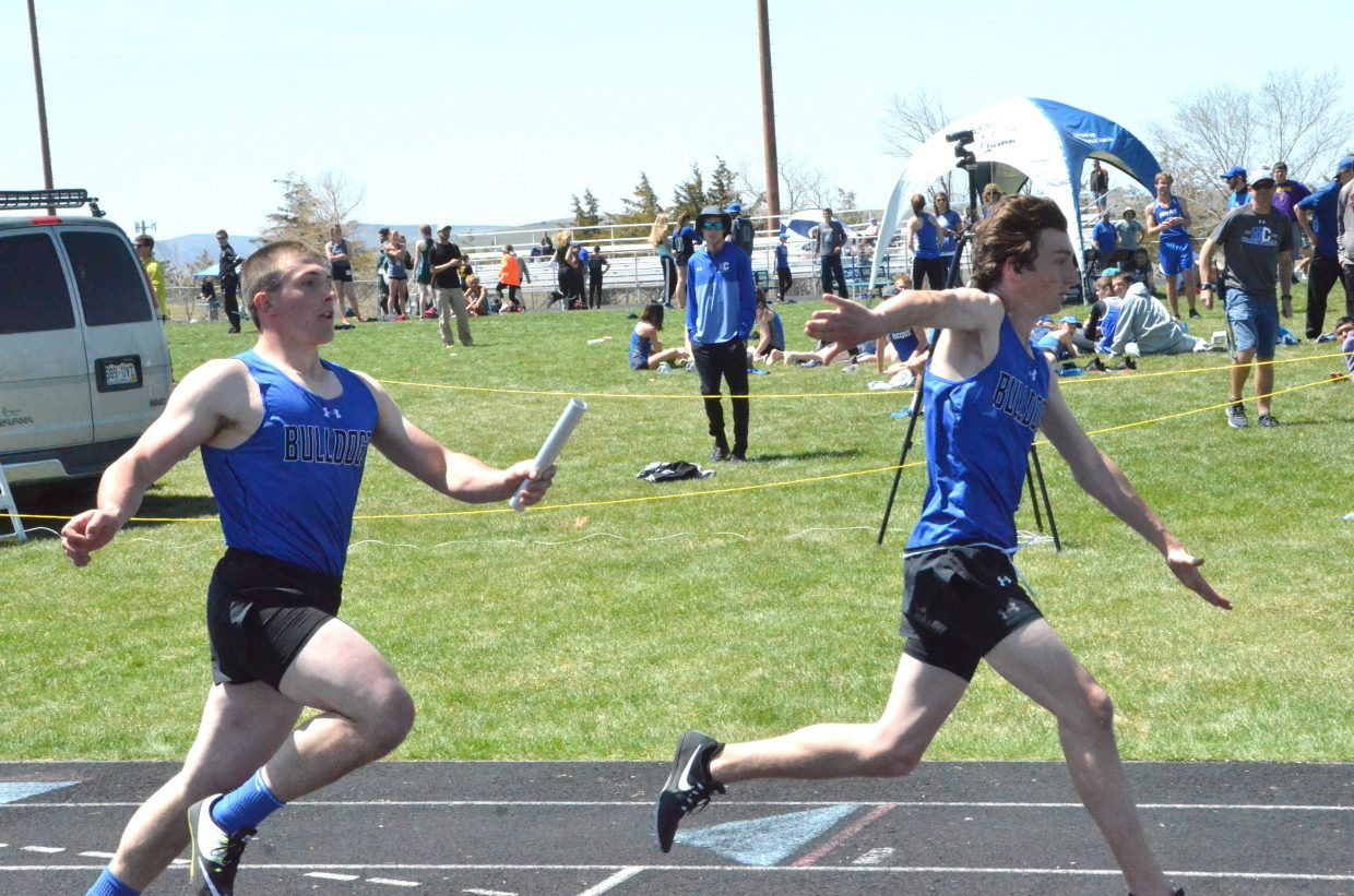 Moffat County High School's AJ Barber, right, reaches back for the handoff from Elias Peroulis in the boys 4x200-meter relay Friday at the Clint Wells Invitational.