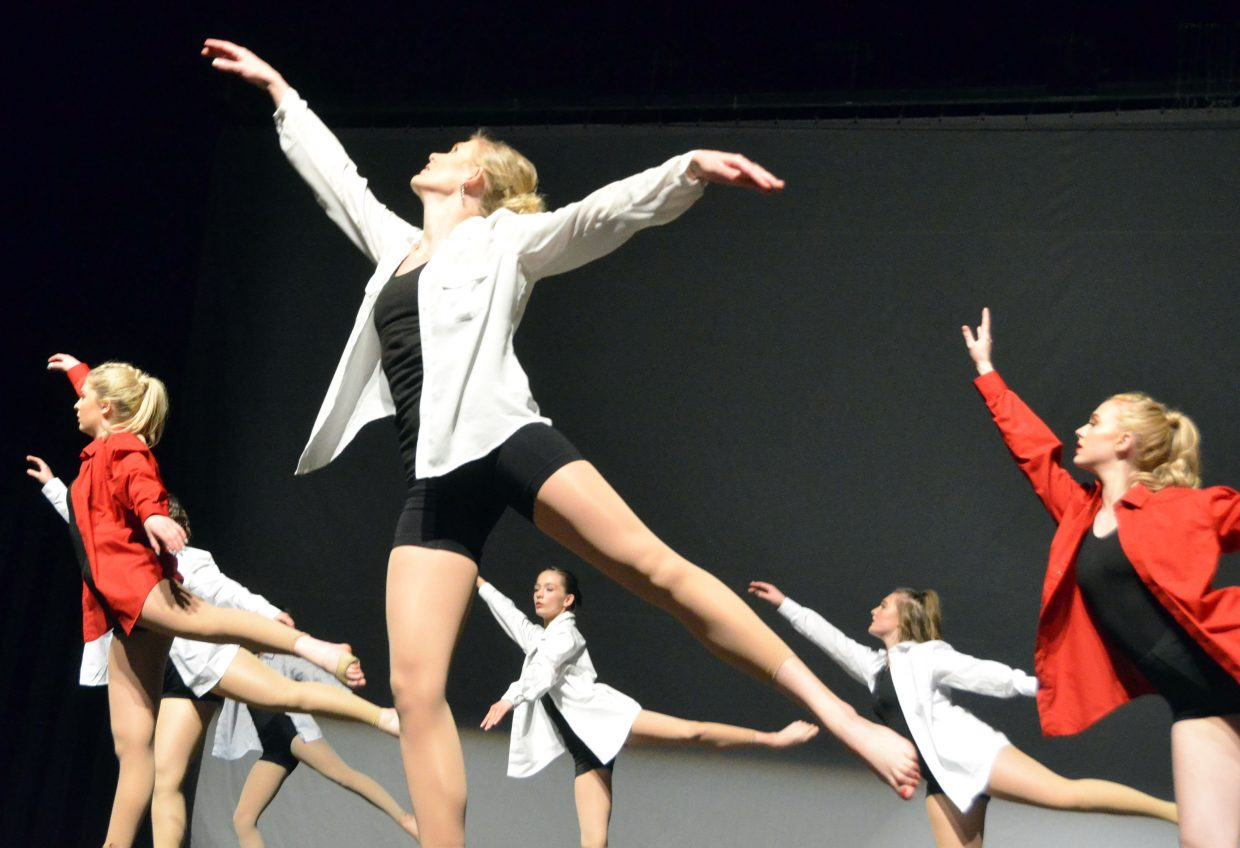 Instructor Jeni Giedd performs alongside the senior company for Just Dance during Saturday's spring recital.