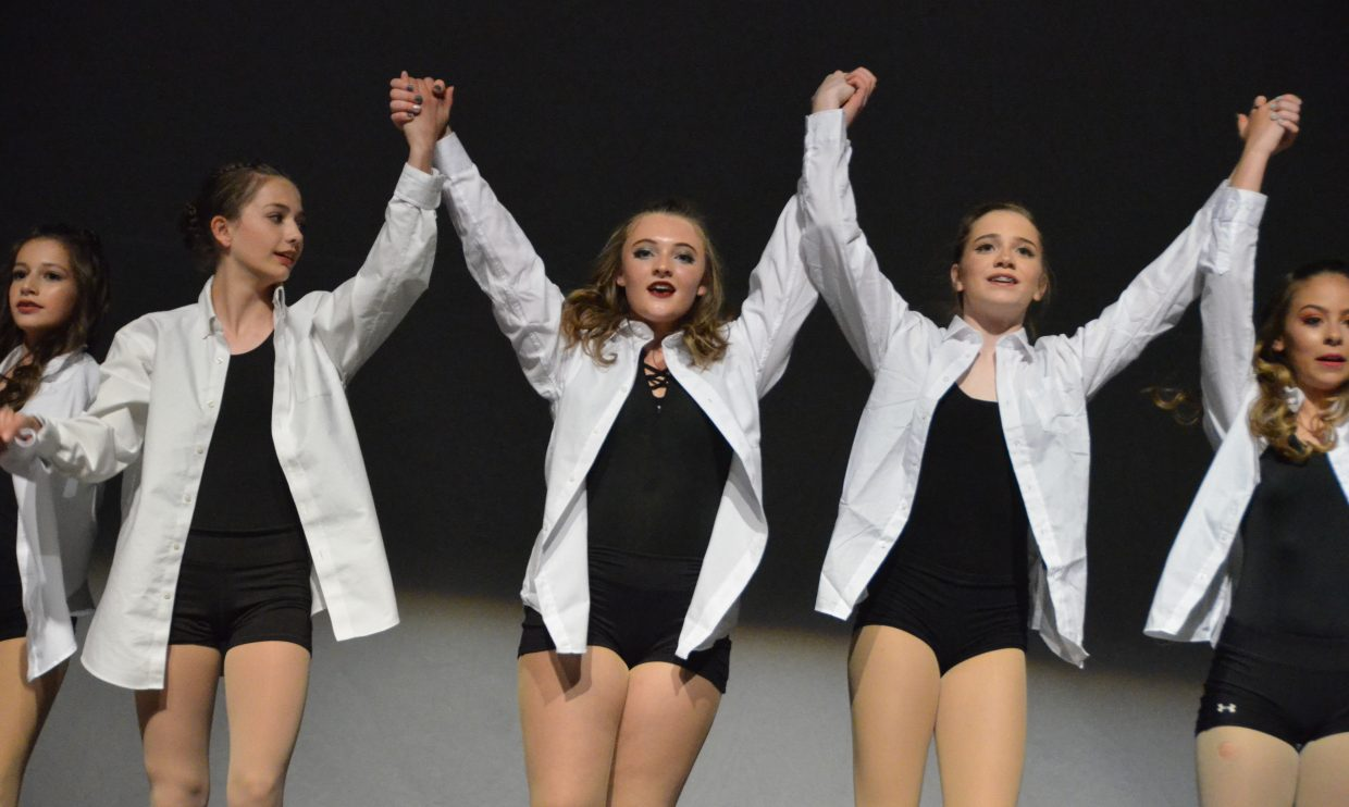 The senior company for Just Dance takes a curtain call following Saturday's spring recital.
