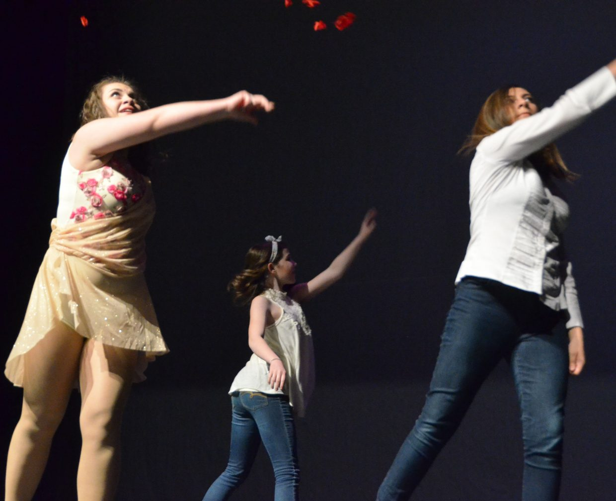KennaLee Rowley and company spread rose petals on the stage during Saturday's Just Dance spring recital.