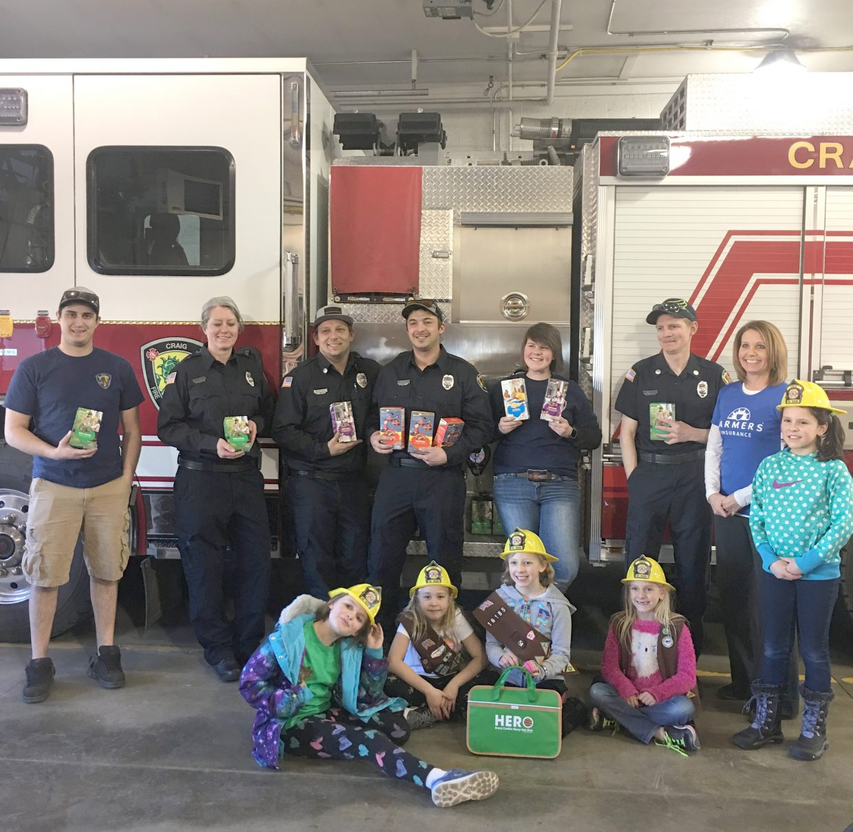 Farmers Insurance Agent Debbie Montgomery helped Haley Duran, Madison Doolin, Audrey Laehr, Xya McMahon and Josie Terry, all of Girl Scout Troop Number 16185, deliver cookies to Craig Fire/Rescue personnel in early March.