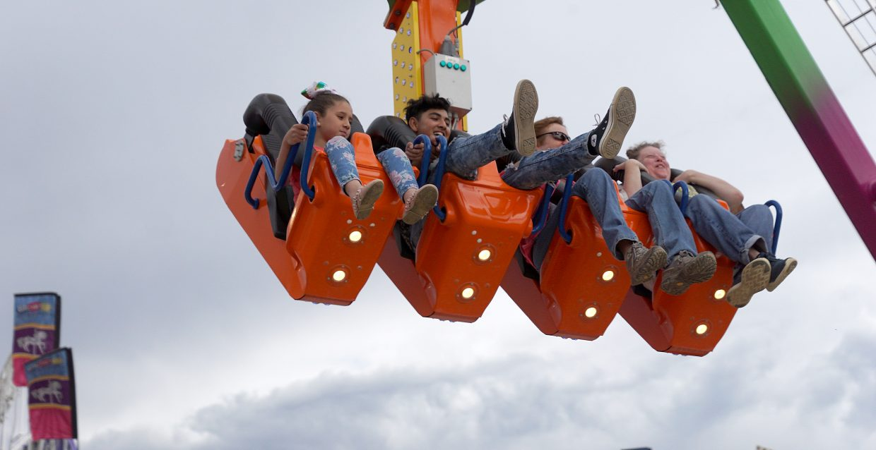Riders dangle far above the ground on the Freak Out ride.