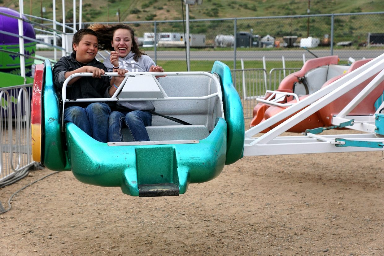 Two riders spin out on the Sizzler.