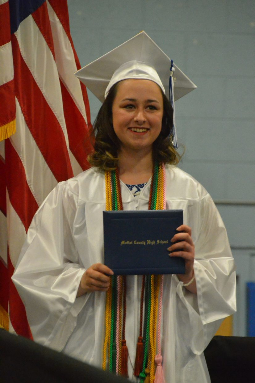 Moffat County High School's Katie Haskins poses with her diploma during Saturday's graduation ceremony.