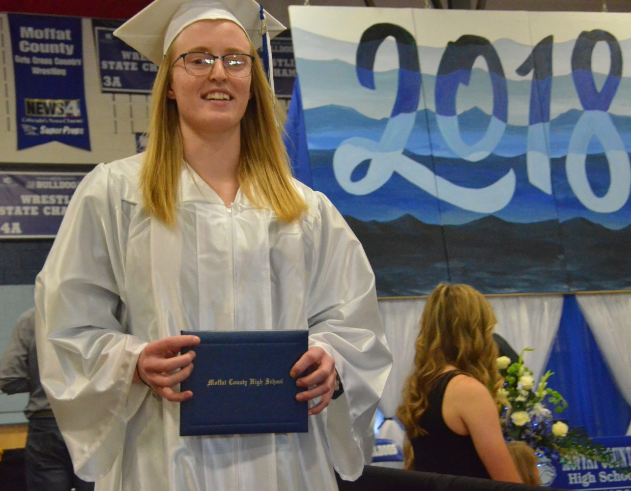 Moffat County High School's Makenna Baker exits the stage after getting her diploma during Saturday's graduation ceremony.