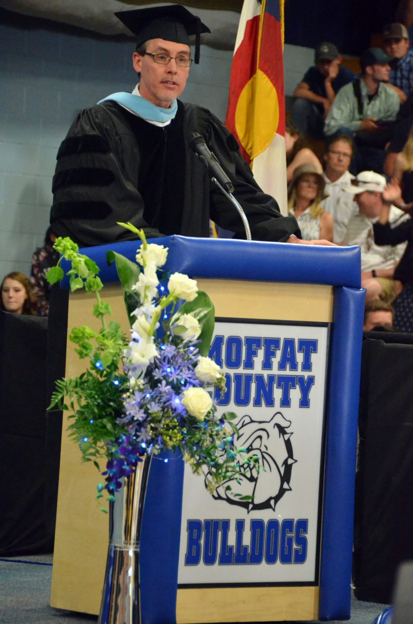 Moffat County School District Superintendent David Ulrich announces the start of diploma distribution during Saturday's graduation ceremony at Moffat County High School.