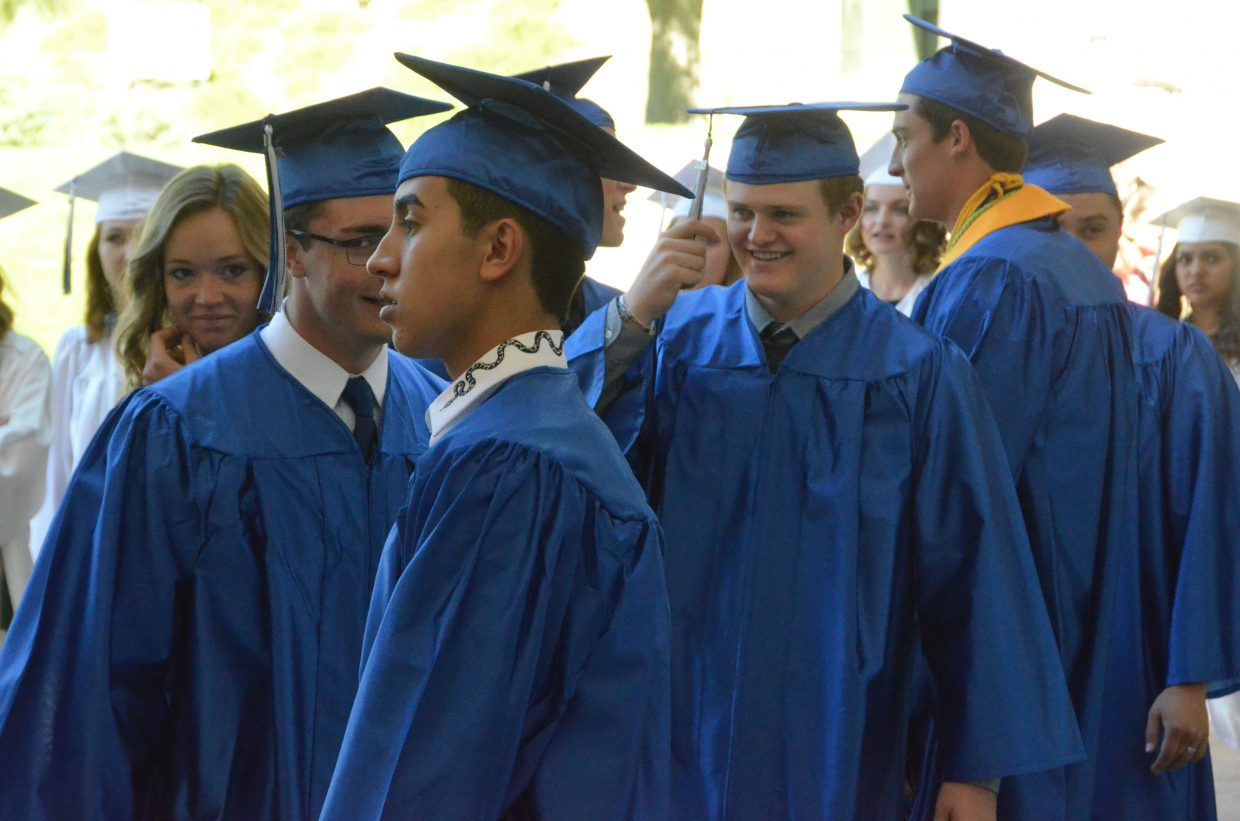 Moffat County High School students mill about and get in line for entry into Saturday's graduation ceremony.