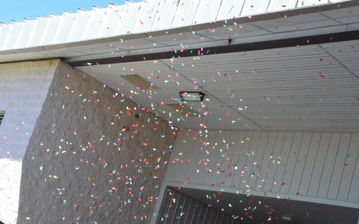 An explosion of confetti hits the air following Saturday's graduation ceremony at Moffat County High School.