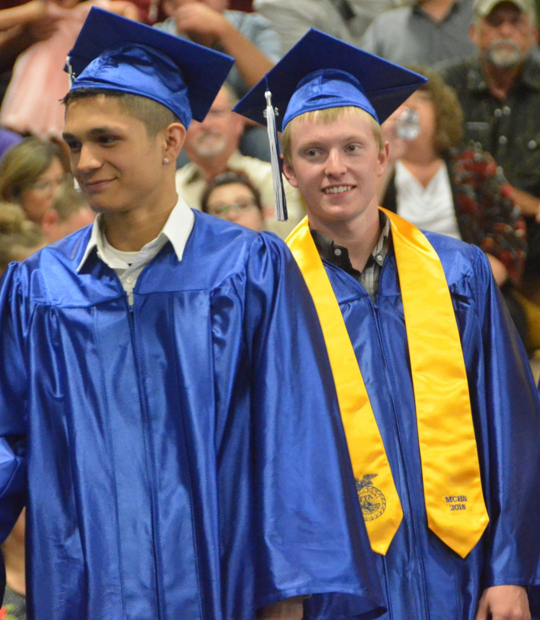 Moffat County High School's Alex Nevarez and Blake Nelson ready to head on stage during Saturday's graduation ceremony.