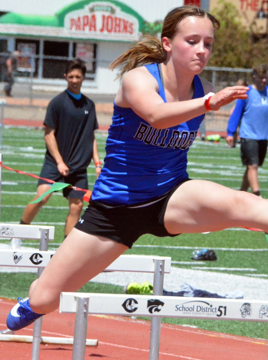 Moffat County High School's Alayna Behrman leaps over a hurdle in the 300-meter race at Saturday's Western Slope Multi-Leagues Meet.