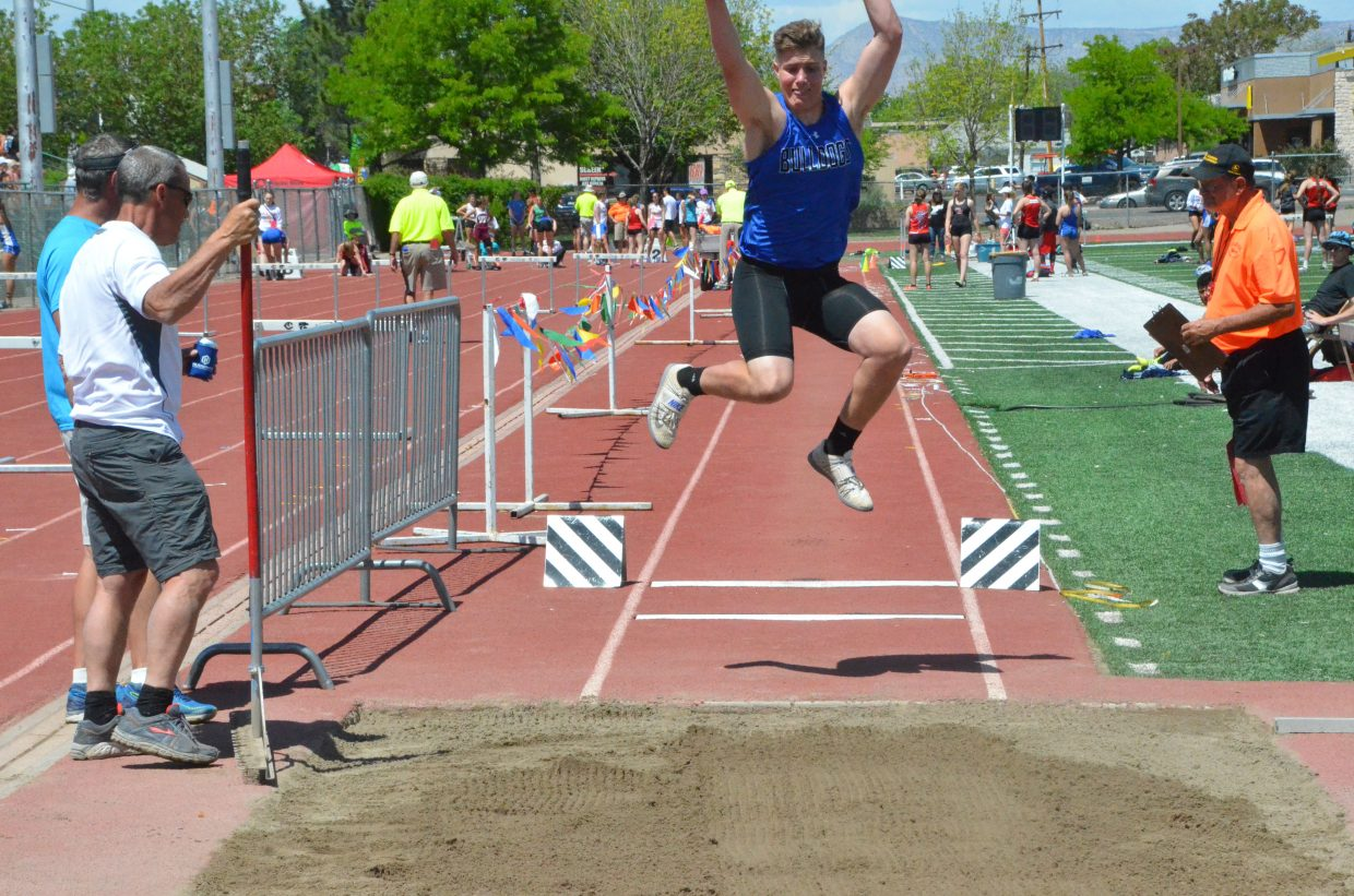 Moffat County High School's Cale Scranton gains some air in the long jump at Saturday's Western Slope Multi-Leagues Meet.