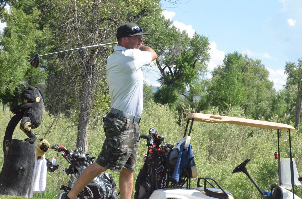 Gypsum's Chan Lockaby follows through on a solid drive from the 14th tee box during the first day of the 51st annual Cottonwood Classic at Yampa Valley Golf Course.