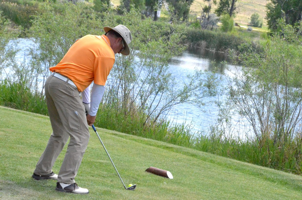 Steamboat Springs' Jeff Nelson addresses his ball on the 16th tee Saturday at the 51st annual Cottonwood Classic at Yampa Valley Golf Course.