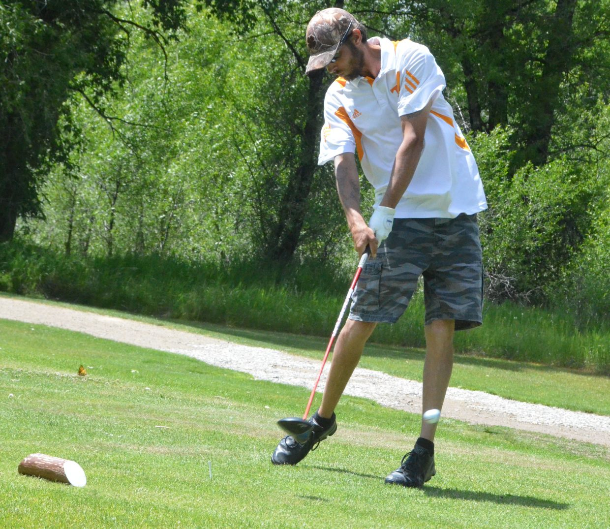Meeker's Jason Mack connects on a drive from the 17th tee Saturday during the 51st annual Cottonwood Classic at Yampa Valley Golf Course.
