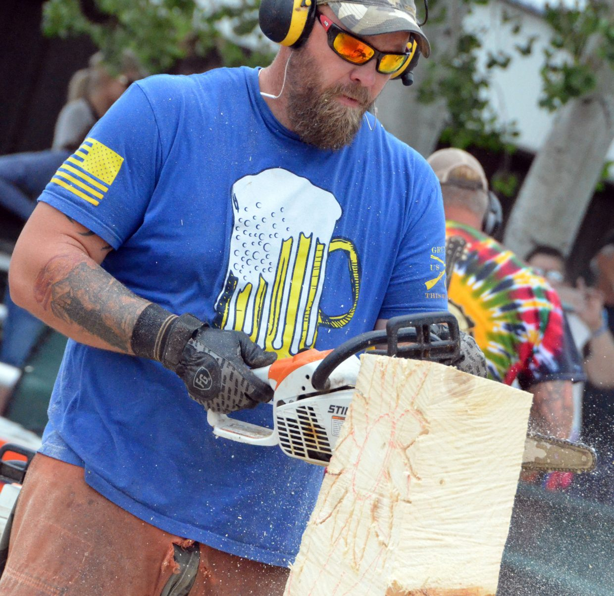 Joe Wenal trims his stump Saturday during the Quick Carve competition at the 19th annual Whittle the Wood Rendezvous.