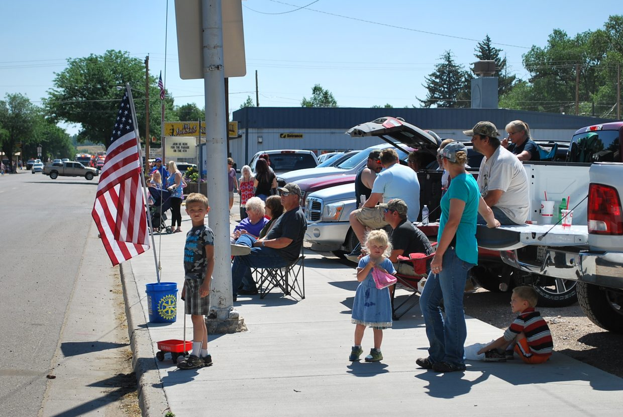 A group of parade goers waited in anticipation for the Fourth of July parade to start.